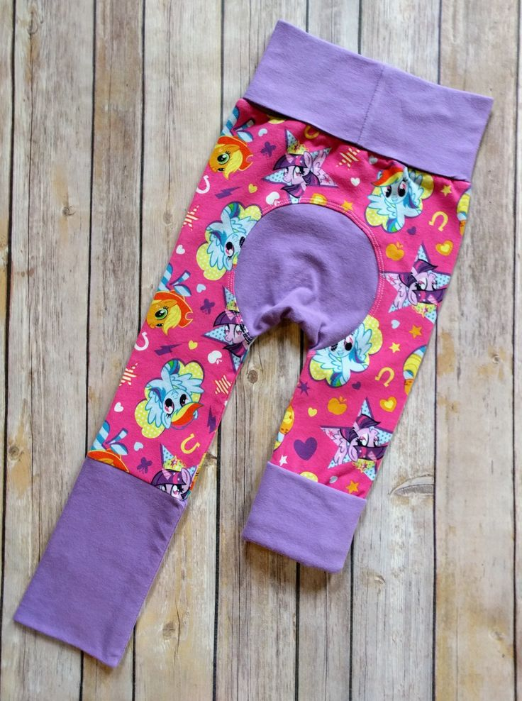 My Little Pony Rainbow Dash Maxaloones Maxaloones are the ultimate cloth diaper pants! They have an extra panel in the back to accommodate for extra fluff and look adorable. These specific pants are designed to fit approx. Size 6 months- 3 years with the adjustable waist and leg bands. Simply roll them up or down for a customizable fit.