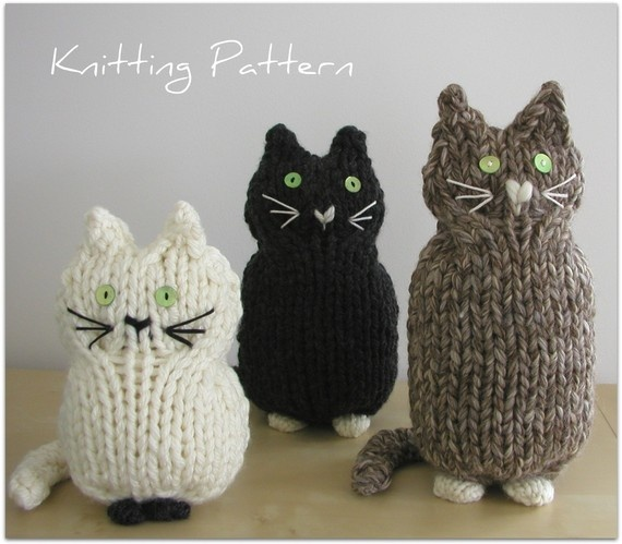 """Knitting Pattern Cat."" These cute cats are quick to knit knitted using a bulky weight yarn with either two or three strands held together. Instructions are given for three sizes. Buttons and sewn on embellishments complete the features. By handknittedthings on Etsy."