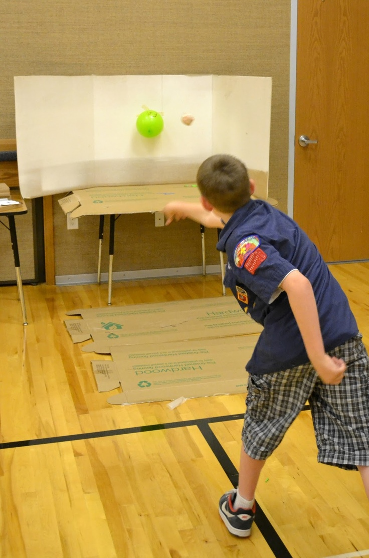 """Cub Master put all the pins and beltloops inside of balloons and had the boys throw """"darts"""" to pop balloons and get their awards."""