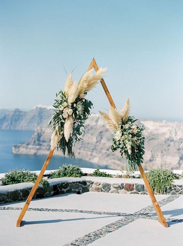 Ceremony arch from wedding on the Greek island of Santorini #destinationweddings #greekwedding
