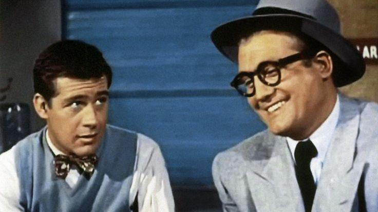 Jack Larson (left) as Jimmy Olsen with George Reeves as Clark Kent in…