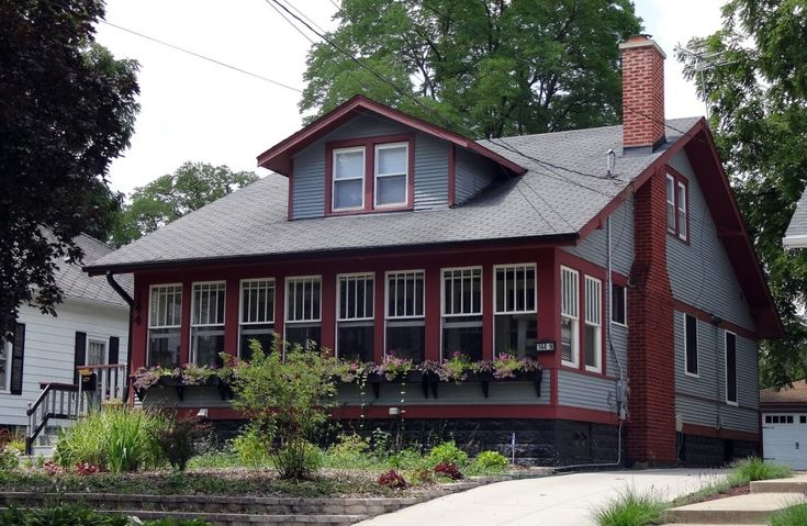 Front Porch Ideas : Home Exterior Design Idea With Enclosed Front Porch Designed With Red Brown Frames Of Glass Windows Combine With Gray Wall And Roof Also Decorated With Flowers Garden