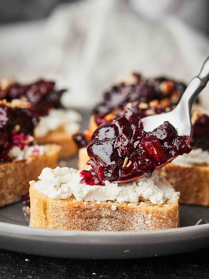 Pinot Noir Cherry Bruschetta Recipe | Take a slice of baguette, slather on goat cheese, and top with a spoonful of cherry compote!