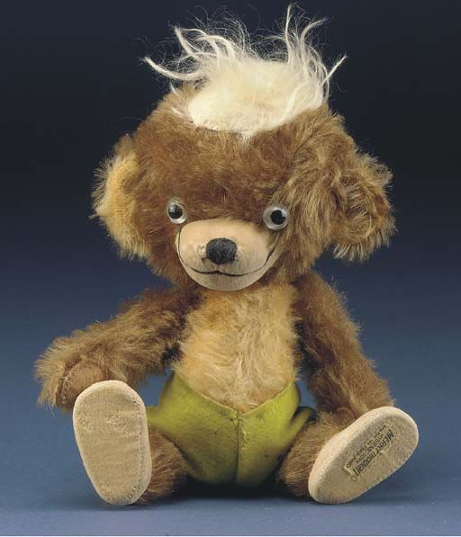 """10"""" stuffed mohair Punkinhead teddy bear toy, with black glass eyes, velvet feet, and felt hand pads, United Kingdom, 1951, by Merrythought."""