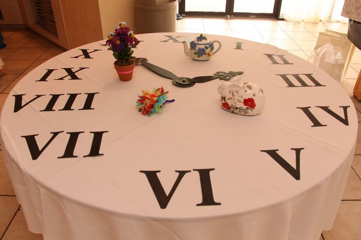 Clock table for Alice in wonderland party
