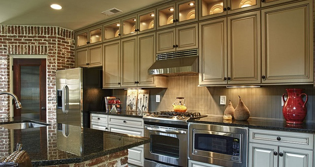 Eudora Cambridge Maple Taupe Coffee Glaze Frameless by Below Wholesale Cabinets, via Flickr