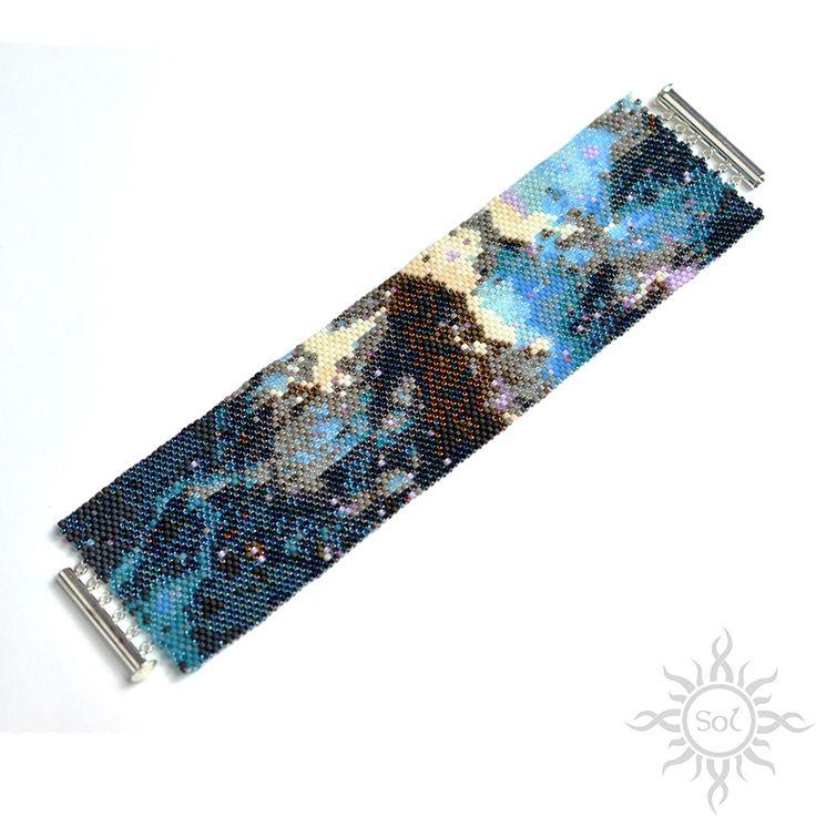 Anna Nieśpiałowska, Sol.   Heart Nebula I – beadwoven cuff bracelet.   http://polandhandmade.pl/kategorie/beading/niespialowska-anna-sol/  #hubbletelescope #fantasyjewelry #widebracelet #galaxyjewelry #spacenebula