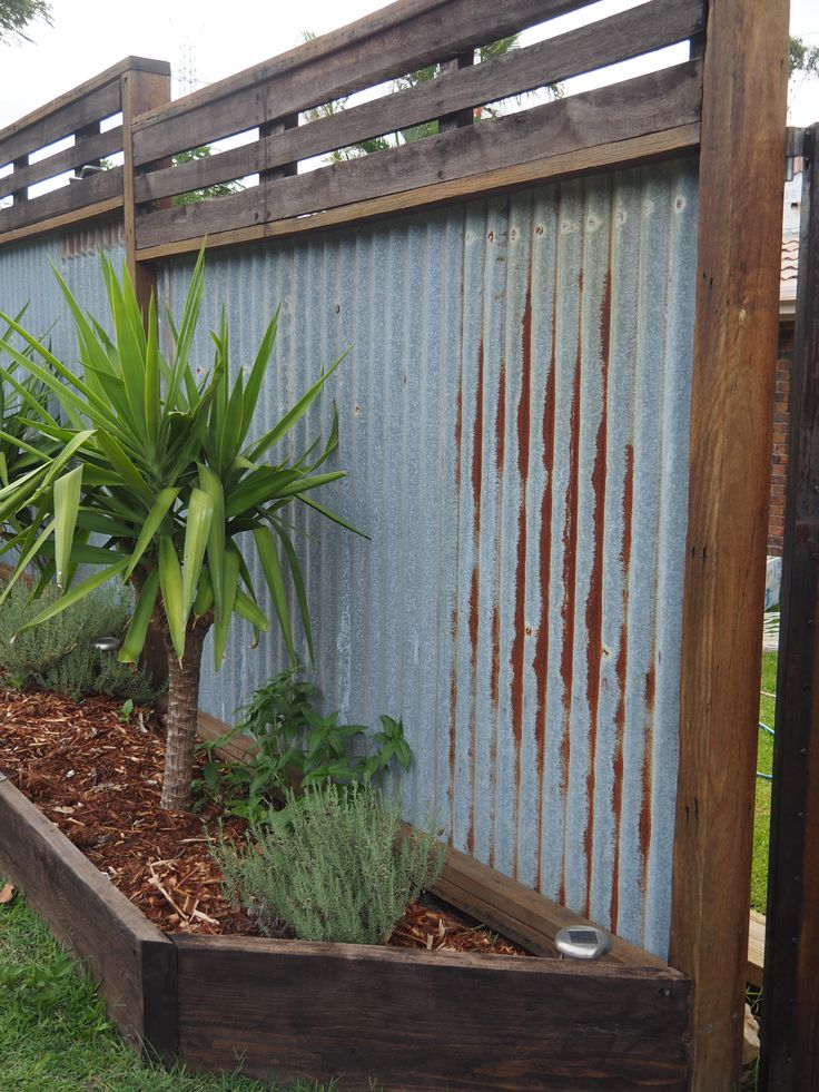 Recycled hardwood timber fence, I dreamed of this for a long time. Rusty corrugated iron. Timber joist and bearers salvaged from 1970's house demolition. De roofed house myself, Planed, sanded & oiled All DIY by Myself .Blocks out the neigbour's and keeps my kids safe. Robina, GOLD COAST, QLD