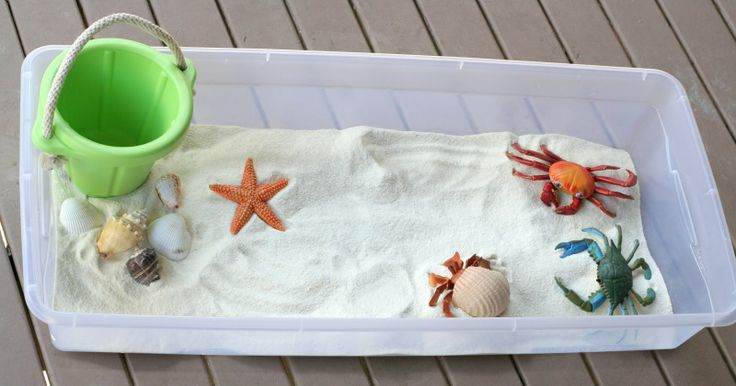 White Cornmeal as sand. Baby/Toddler Beach Sensory Bin with Edible Sand! from Fun at Home with Kids