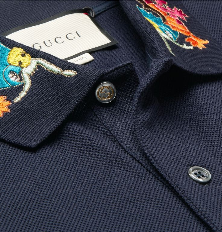 For Spring '17, <a href='http://www.mrporter.com/mens/Designers/Gucci'>Gucci</a> uses exquisite embroidery to add 'eclectic and unexpected touches to classic silhouettes'. This polo shirt has been made in Italy from stretch-cotton piqué and has vibrant magenta, green and gold dragons at the collar. Keep the rest of your look simple.