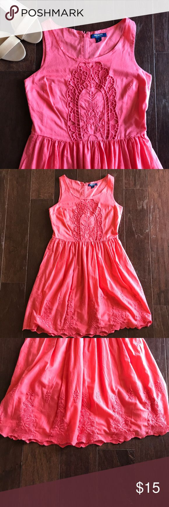 Coral Sundress This beautiful coral sundress is a great addition to any wardrobe! Lightweight and airy, dress features crochet pattern on front of dress and scalloped crochet hemline on bottom. Fully lined with hidden back zipper. Color most accurate in pictures where dress is hanging. From a smoke free and pet free home! Old Navy Dresses