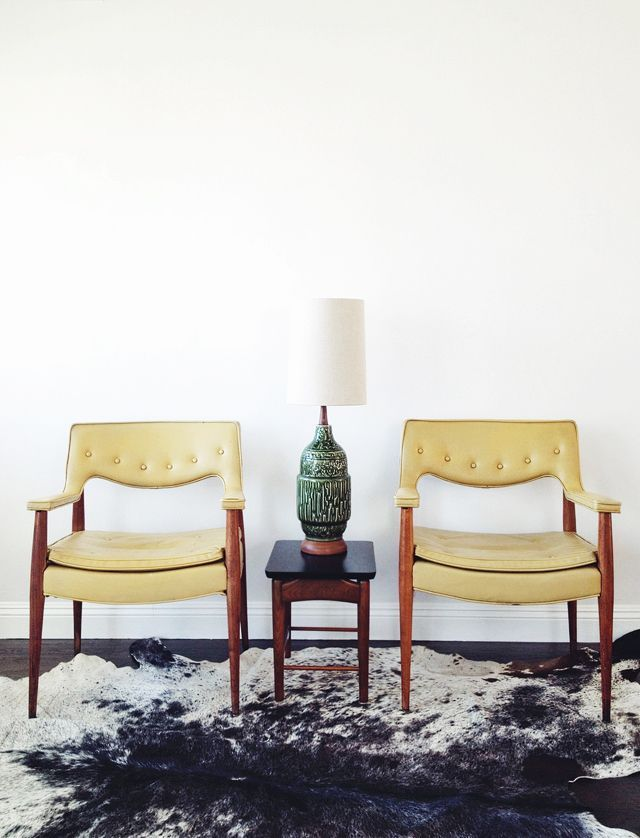 Retro furniture with slim legs look elegant on a rustic cowhide. Don Draper would approve!