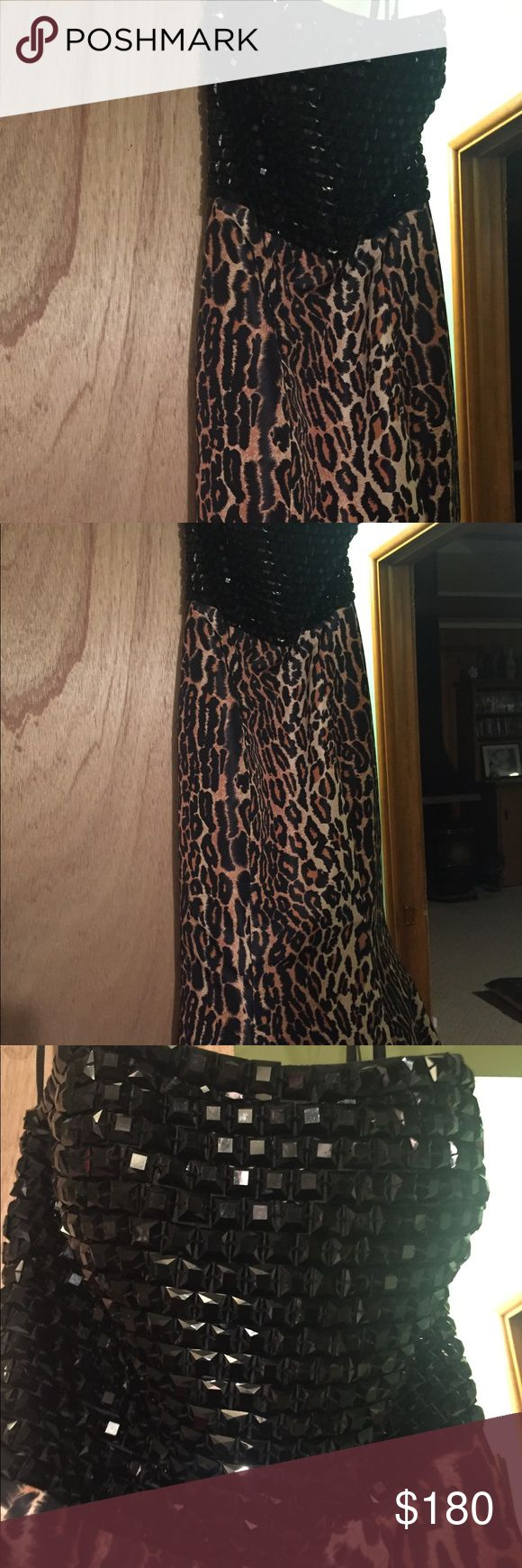 Sherri Hill leopard print sample gown Amazing Sherri Hill gown! Leopard print with black beading- strapless new with tag- size 0. Own a Sherri Hill for a fraction of the price! Sherri Hill Dresses Prom