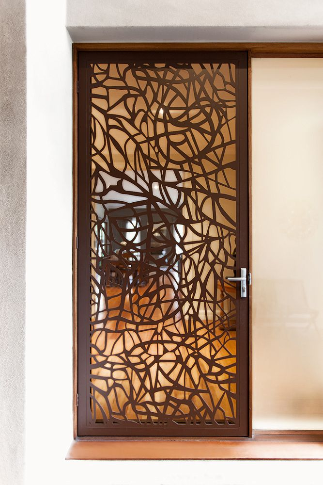 Security Screen Doors - Custom design flexibility or choose from our existing range. Powder coated corten paint finish