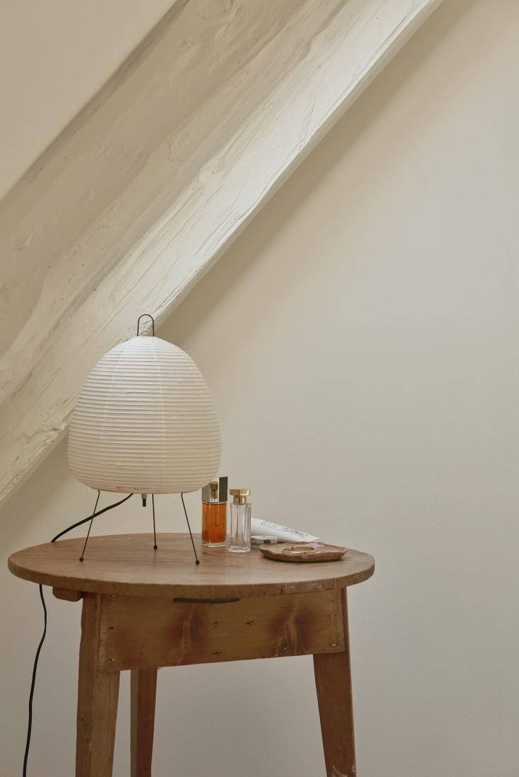 Noguchi lamp on side table in Copenhagen apartment.