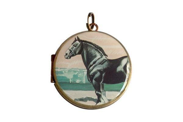 Featuring a stunning black horse, this original postage stamp was printed by Bulgaria in 1991.  The vintage locket is made from brass and copper and measures 30mm in diameter. The locket opens from the side and is capable of holding 2 of your most precious memories inside.