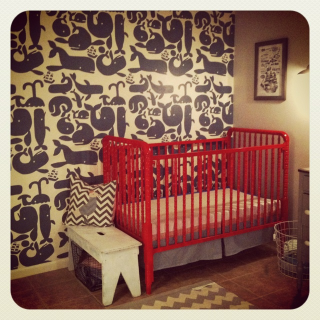 Love this crib!!  DIY whale wallpaper. make a stenciled whale wall. Cost was $11. Nautical nursery. Red painted crib.