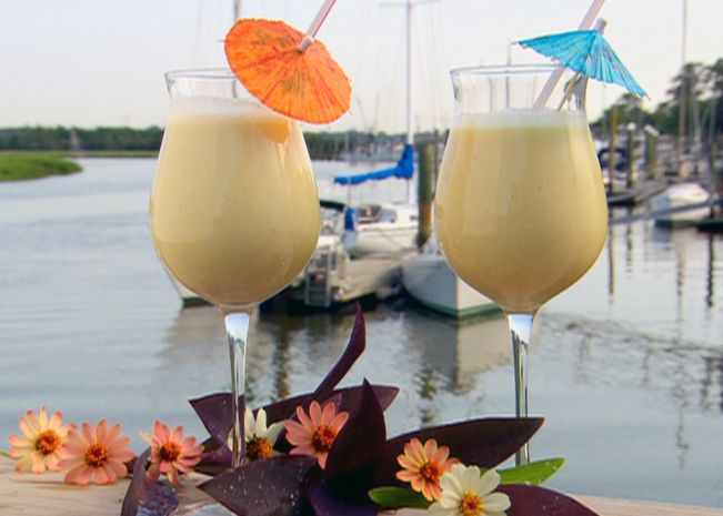 1 cup fresh pineapple chunks 1 cup unsweetened coconut milk 1 banana 1/4 cup ice cubes 2 teaspoons honey, optional