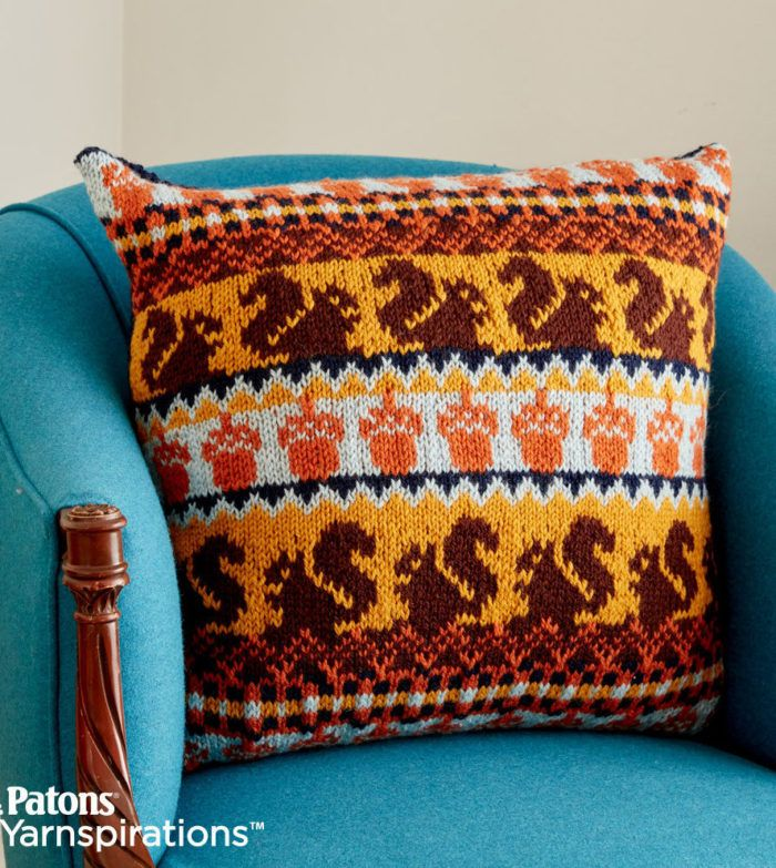 Free Knitting Pattern for Autumn Harvest Knit Pillow - Fair-isle pillow cover with a squirrel and acorn design. 20″ square. Designed by Patons