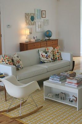 Eames rocker chair, Orla Kiely pillows, a globe and white!