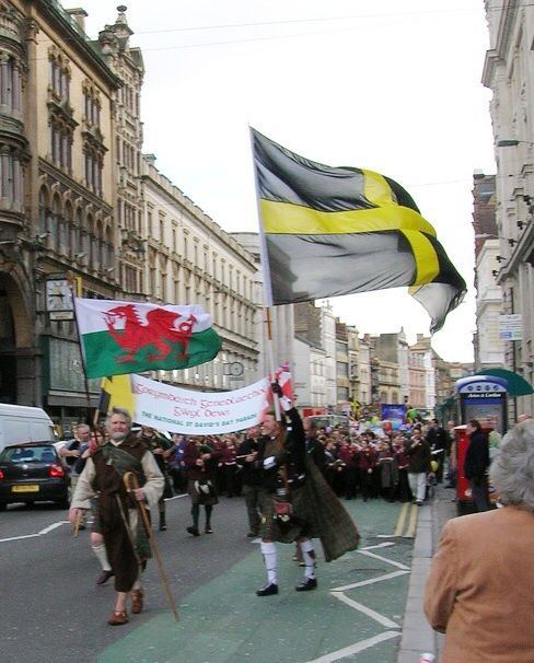 The flag of Wales on the left and on the right, the flag of Saint David, the patron Saint of Wales - Celebrations for Saint David's Day 1st March