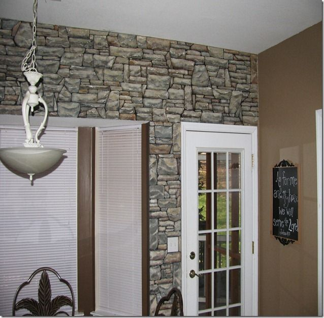Faux painted stacked stone wall.