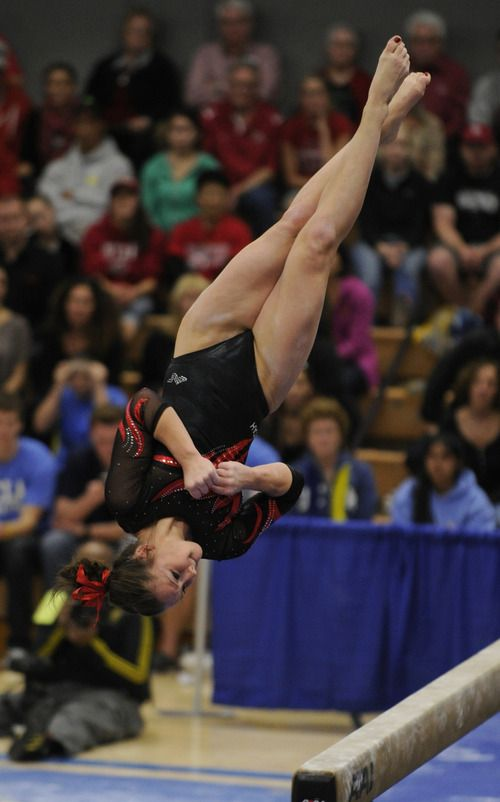 Stephanie McAllister flys to a 9.85 on the beam. The Utah women's gymnastic team traveled to Los Angeles to compete with UCLA at the Wooden Center, located in the center of the Westwood Campus. Westwood, CA 1/8/2012(John McCoy/Staff Photographer)  (500×802)