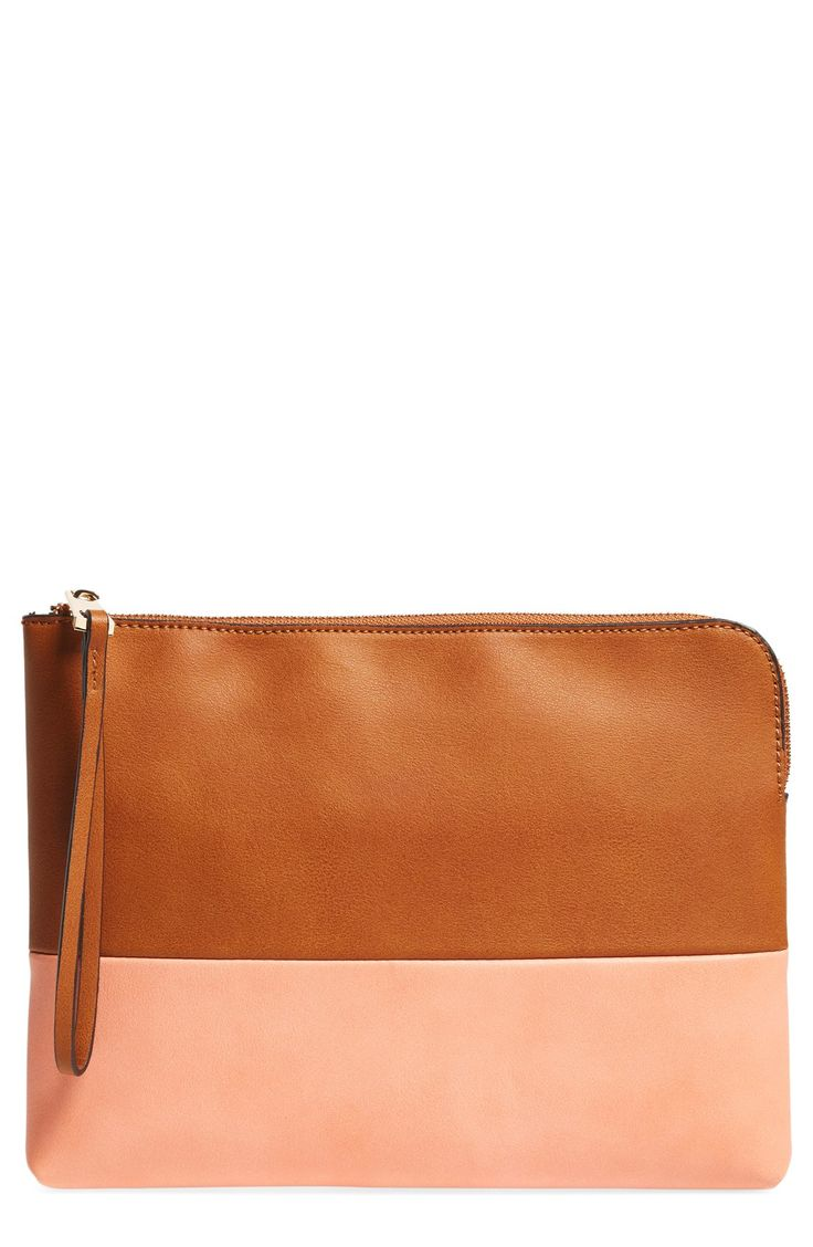 This gorgeous two-tone wristlet in coral and brown leather is perfect for carrying the essentials.