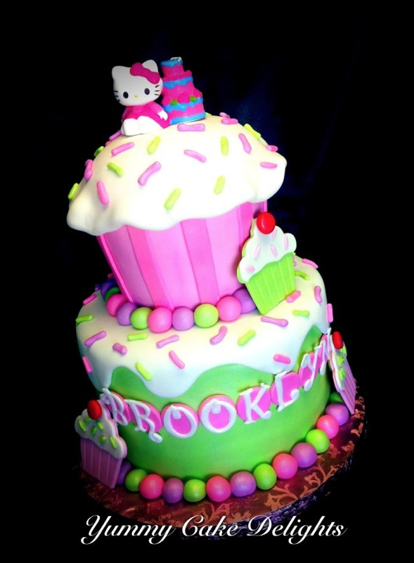 Hello Kitty Icing Cake Design : Cutesy 2 tiered cake with icing on top Hello Kitty themed ...