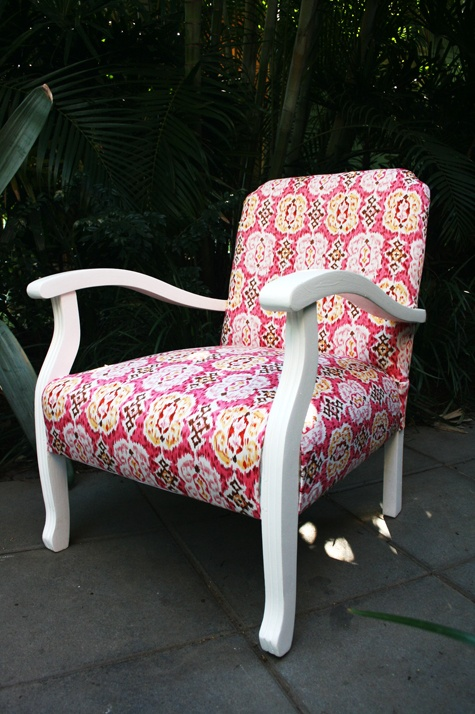 Beautifully refurbished 1940s bedroom chair upholstered with ikat fabric in pink, dark red, yellow, brown and white.