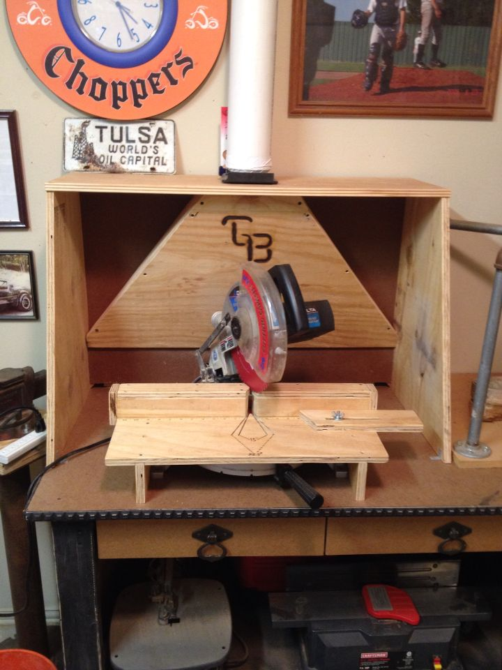 Homemade sawdust hood connected to attic dust vac.  Works great with miter saw and joiner, router table, etc.