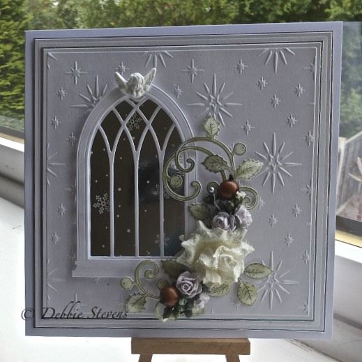 Morning everyone,A simple christmas card to show this morning, I have used Spellbinders grand squares, Spellbinders/heartfelt creations ornamental add on( leaves) with matching stamp memory box lar...