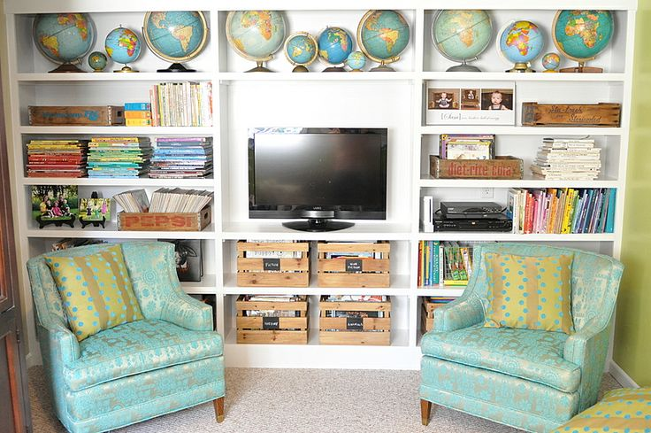 I like the colors and layout, but would replace the TV with a poster, if it were in my library....  via @Charmaine Ng Wonder if this homeliness could be replicated in public or school spaces.: Book Shelf, Bookshelves, Book Displays, Room Bookcases, Book Organization, Book Shelves, Reading Rooms, Bedroom Sitting Room, Home Bathrooms