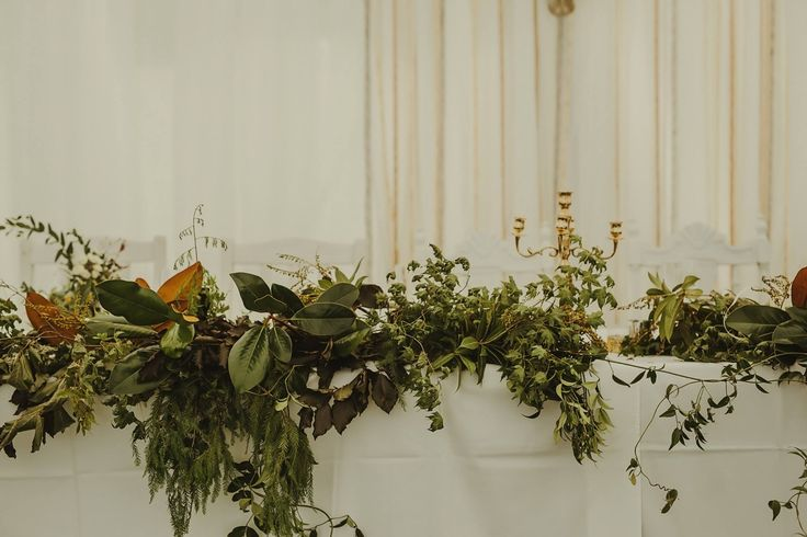 Bridal table foliage at Liddington gardens wedding. Photography Danelle Bohane