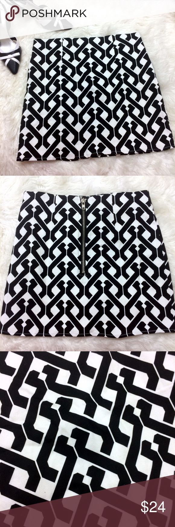 """Geometric Design Mini Skirt w zipper Cute skirt with geometric patterns. Black and white is a classic! Add a Ruffle Blouse, blazer and heels for the office. A tank and platforms can take this office skirt to a going out skirt!   Great used condition  Zipper on back, fully lined marker on tag as shown  size S  14"""" waist 15"""" length 95% cotton 5% spandex Emmelee Skirts Mini"""