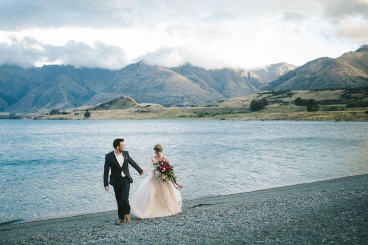 The beautiful ceremony of Alex & Lisa of @2people1life.  Delighted to dress both the beautiful #bride & the handsome #groom! #queenstown #newzealand #wedding #lake #lakewakatipu #loveis #marriage #alexandlisa @emilyadamson photography  / @nemoworkroom dress and suit http://2people1life.com/blog/