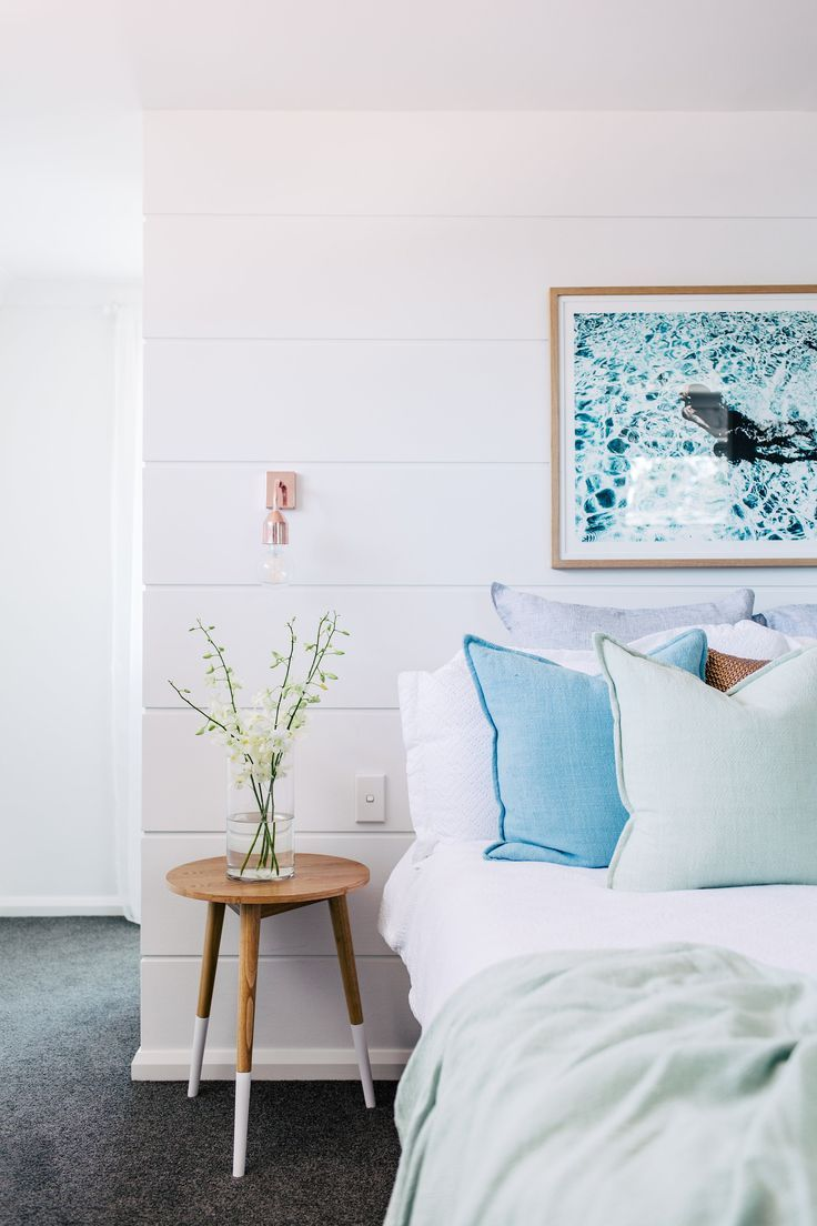 Bright bedroom with stool as nightstand