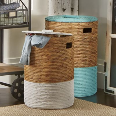 "Set of 2 Laundry hampers - $129.99 Woven seagrass hampers w/lids have cutout handles, painted lids & bottoms & washable fabric liners. Tall - 14"" diameter  x 31 1/4"" H Short - 16"" diameter x 23 3/4 "" H"