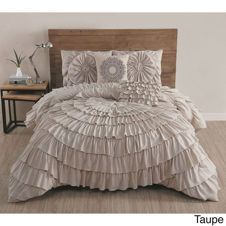 Get an expensive designer look for less. This elegant comforter set easily adds style and class to your bedroom. Featuring beautiful circular ruffles, this charming comforter has a solid reverse patte