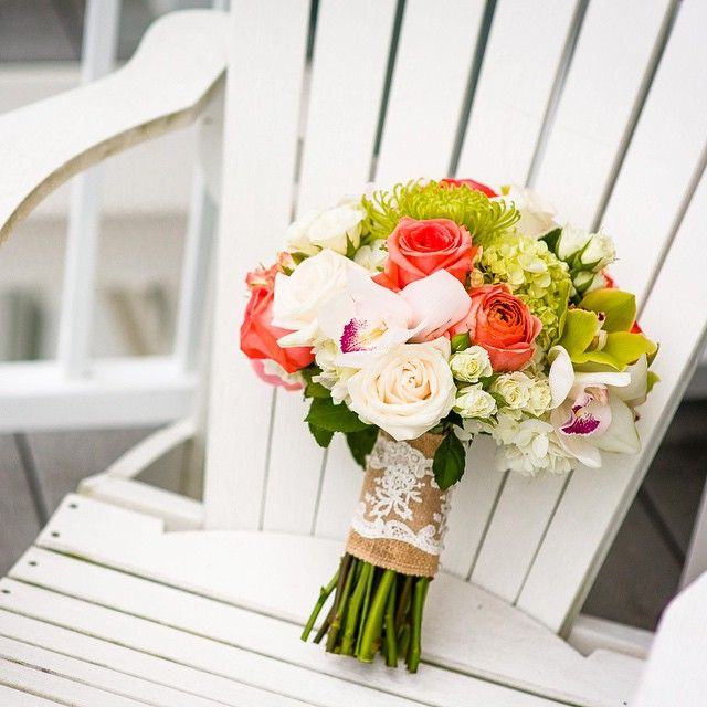 Perfect Muskoka Wedding flowers in a Muskoka chair.