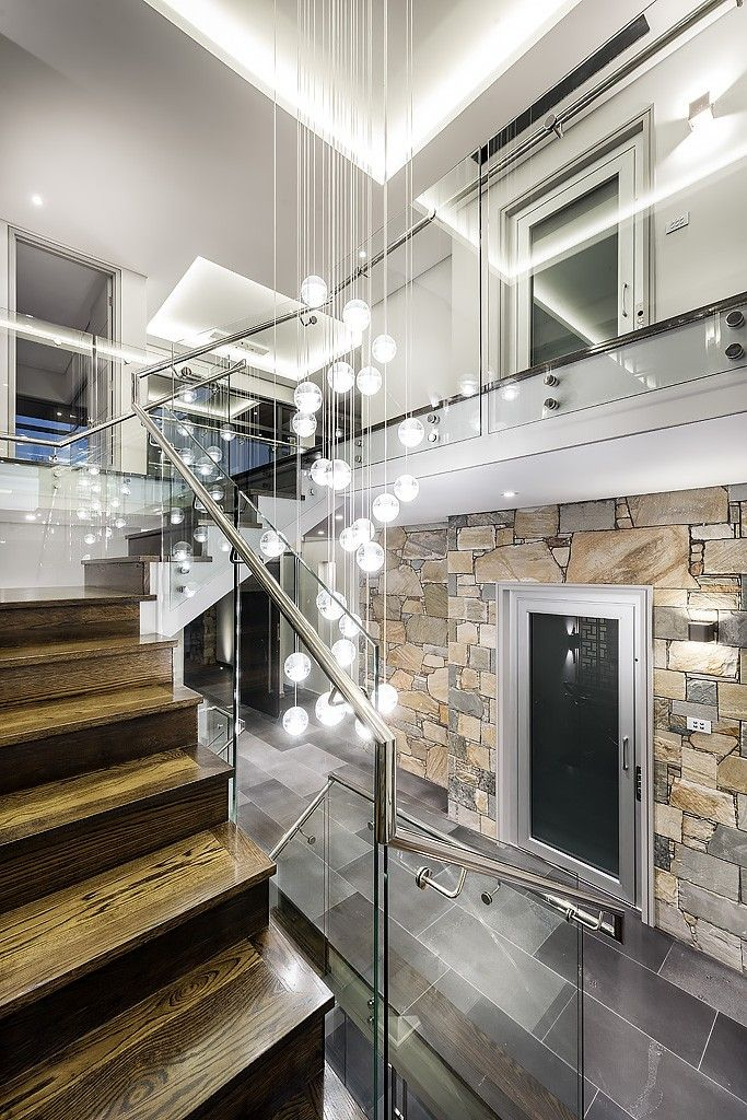 Striking Central Staircase Including Stained American Oak Timber With  Stainless Steel And Glass Balustrading Against A Laser Cut Screen In City  Beach By ...