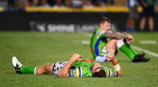 Two Raiders players look dejected after losing the round one NRL match between the North Queensland Cowboys and the Canberra Raiders at 1300SMILES Stadium on March 4, 2017 in Townsville, Australia.
