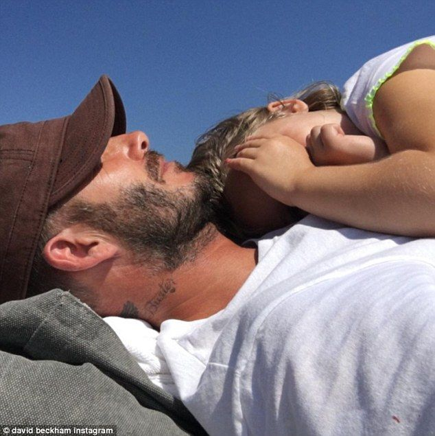 Daddy and daughter time: David Beckham made hearts melt when he shared an adorable picture of daughter Harper, five, slumbering on his chest in the sunshine