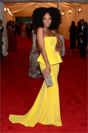 Loving Solange Knowles in this Rachel Roy yellow peplum gown!