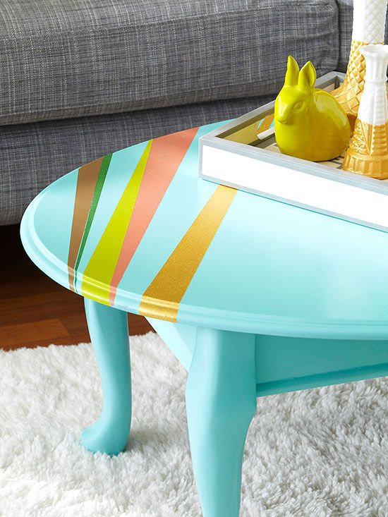 Contemporary color and pattern help offset this table's traditional lines. Clean and dry the surface, then sand with 400-grit sandpaper. Wipe with a tack cloth; prime and paint, letting dry between coats. For the sunburst design, start at the edge of the table and use painter's tape to tape off angles. Paint with oil-base enamel colors using a stencil brush; remove tape when dry. For a glossy sheen, spray on a lacquer top coat./