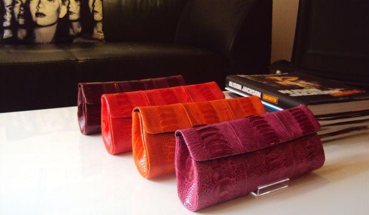 Naledi Copenhagen ostrich clutches in berry colours