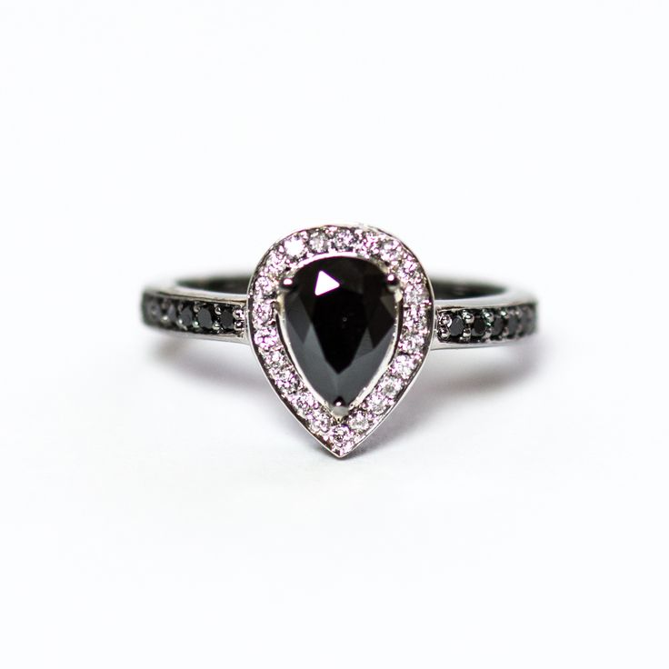 Quantity Available - 0  Black diamondpear andwhite diamond halo black gold ringThis is a black diamond pear cut amethyst with white diamonds around it and black diamonds on the ring band. The ring is 14k gold plated with black gold.Ring specifications:• Ring is size 7, but can be fitted to your size. Ask for your size.• Black diamond pear cut approximately 0.92 carat measuring approximately 5.8mm wide x 8.2mm long. Treatment: Heat treated.• 14k white gold band plated with black gold.• 14…