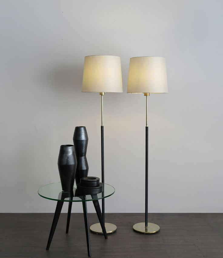 60S Falkenbergs Belysning leather svedish floor lamp with brass base and new shade. - 50s italian coffe table - Italian ceramics vases turned and hand-engraved, black enamel with metallic effect. - Set of italian ashtrays model Barbados designed by Angelo Mangiarotti for Danese Milano in 1964