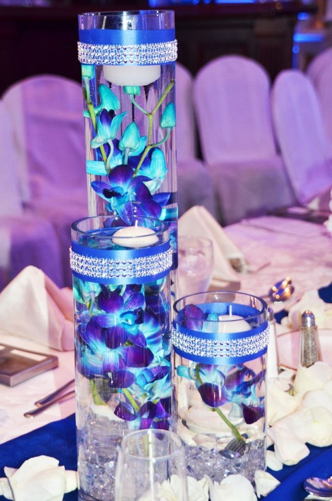 Floating blue submerged orchids with floating candles. without bling wrap