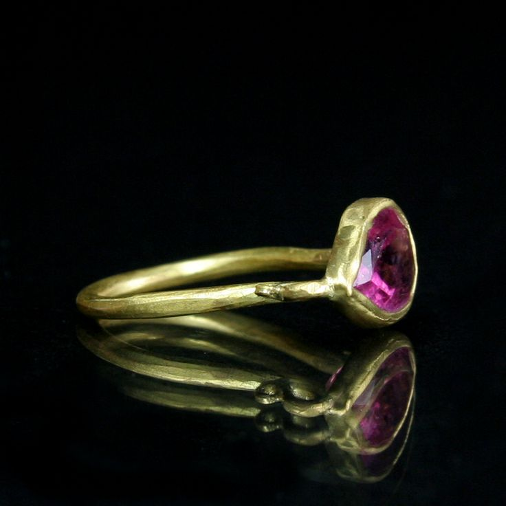 This 22K Gold bezel set 4.03 ct. pink Tourmaline stone measures 2x1cm and fits a size 7.5 finger.